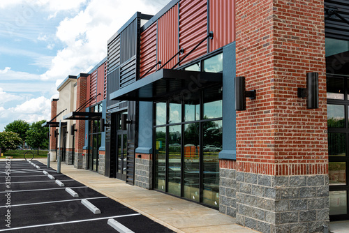 Fotografiet New Shopping Strip Center Almost Ready to Open