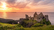canvas print picture - Ruined medieval Dunluce Castle on the cliff at amazing sunset, Wild Atlantic Way, Bushmills, County Antrim, Northern Ireland. Filming location of popular TV show, Game of Thrones, Castle Greyjoy