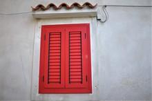 Red Closed Shutters On Mediterranean Street