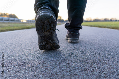 The close up shot of walking shoes on the road, selected focus on the left shoe #315473078