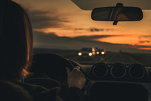 Woman Driving Car In Dusk