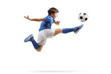 Boy In A Sports Jersey Jumping And Kicking A Soccer Ball