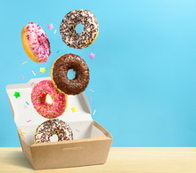 Donuts Falling In Paper Box On...