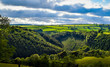 Rural Cornish lanscape, Cornwall, dramatic and dynamic sunny lanscape with green hills and cloudy blue sky