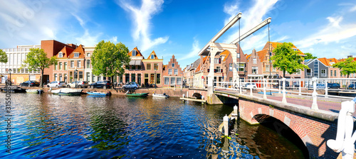 Historic old town of Alkmaar, North Holland, with typical canal houses and draw bridge