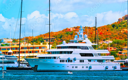 Photo  Scenery with Marina and luxury yachts at Mediterranean Sea of Porto Cervo in Sardinia Island of Italy in summer