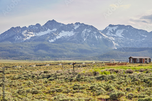 Log Cabin nestled in the middle of the Sawtooth Mountains out west in the Rocky Mts
