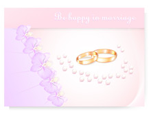 Orchid Pattern With Wedding Rings And Scattered Beads