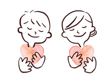 Couple Hugging A Heart And Smiling