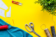 canvas print picture - Sewing wokrshop. Textile, pattern, scissors, thread on yellow background top-down copy space