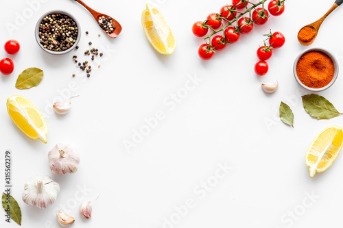 Fotomural Kitchen frame with spices and food - pepper, garlic, cherry tomatoes - on white