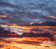 canvas print picture - Sunrise clouds. Dramatic magical sunset over orange cloudy sky