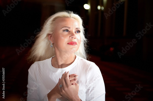 Portrait of ugly woman in the city at night with lighting flashes in the black background