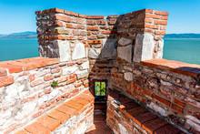 Castiglione Del Lago Medieval Fortress Fort Wall Corner In Umbria, Italy And Rocca With Medievale O Rocca Del Leone Tower And Lake Trasimeno View