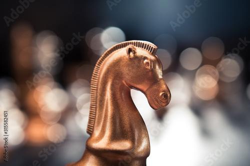 Fototapeta Golden luxury chess piece knight obraz