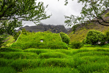 Hof, Iceland Church, The Last Build In Traditional Turf Style, Hofskirkja Building Roof Covered In Green Grass With Window