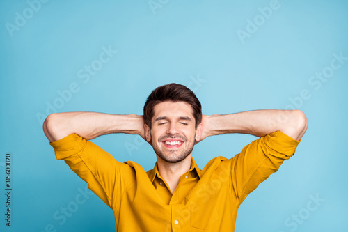 Photo of cheerful attractive guy readying to fall asleep smiling toothily restin Canvas Print