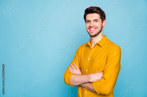 Obraz Profile side view portrait of his he nice attractive content cheerful cheery brown-haired guy folded arms isolated over bright vivid shine vibrant blue green turquoise color background - fototapety do salonu