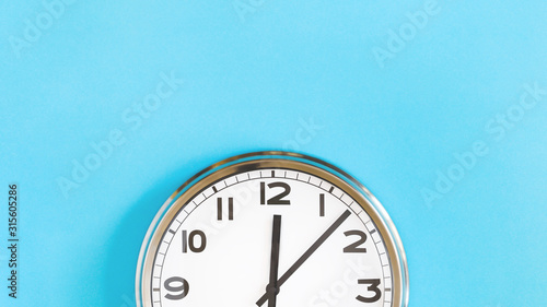 Fotografie, Tablou Top of big plain wall clock on pastel blue background