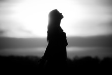 Youth Woman Soul At White Sun Meditation Awaiting Future Times. Silhouette In Front Of Sunset Or Sunrise In Summer Nature. Symbol For Healing Burnout Therapy, Wellness Relaxation Or Resurrection