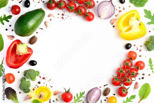 Organic fresh vegetables frame on white background. Healthy food or diet concept. Flat lay, top view, copispace.