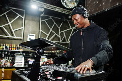 African american dj play music on decks at night club. Canvas Print