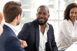 Multiethnic male colleagues talk sharing ideas at briefing
