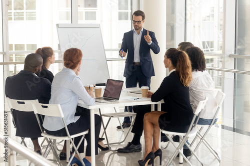 Stampa su Tela Male coach make whiteboard presentation for diverse employees