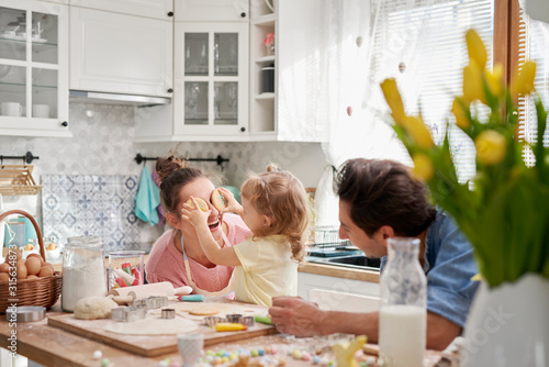 Fototapeta Playful family enjoy baking cookies together