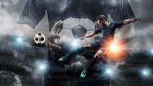 Soccer Player Kicks The Ball O...