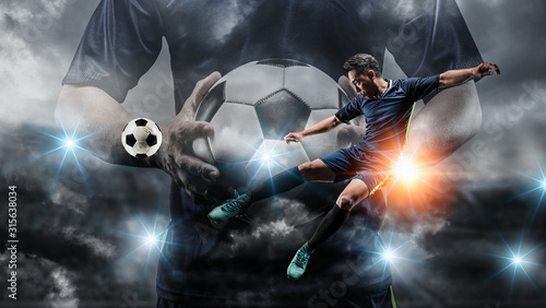 Fotomural Soccer player kicks the ball on the soccer field