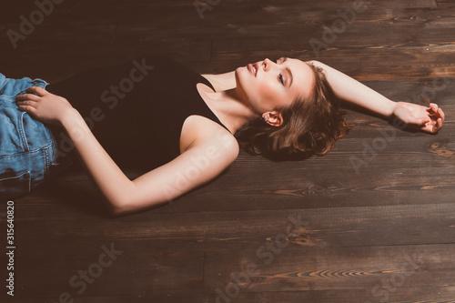 Obraz na plátně woman lying on the floor