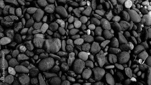 Obraz black pebble beach stone background - fototapety do salonu
