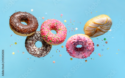 Flying donuts Wallpaper Mural