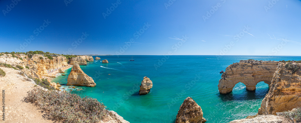 Fototapeta View on typical cliffy beach at Algarve coastline in Portugal in summer