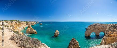 Photo View on typical cliffy beach at Algarve coastline in Portugal in summer