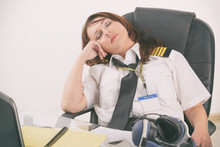 Woman Airline Pilot Sleeping I...