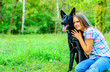 canvas print picture - Portrait of young teenage girl with a shepherd dog in the park outdoor
