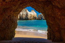 Natural Caves In The Impressive Cliffs Of Algarve Coast In Portugal In Summer