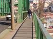March 17, 2017; Belgrade, Serbia; Pedestrian and car crossing old bridge above Sava river.