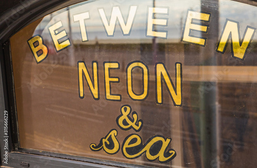 Photo Blackpool, England, 08/09/19 Between Neon & Sea painted onto the window of the a