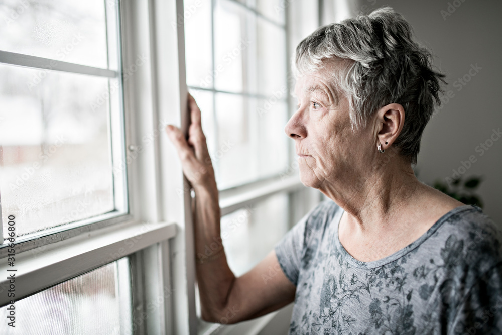 Fototapeta A sad lonely 70 years old senior in is apartment