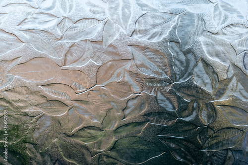 Fotografia, Obraz Frosted, decorative glass bathroom window with leaves embossed into the glass