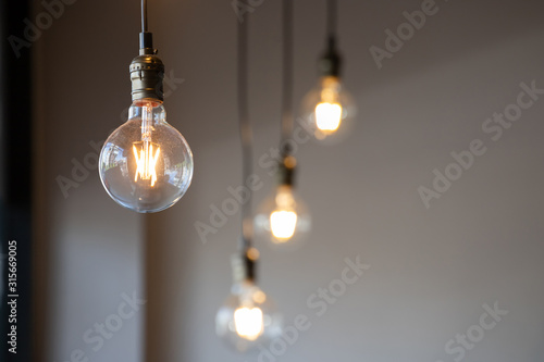 vintage light bulb hanging from ceiling for decoration in living room Wallpaper Mural