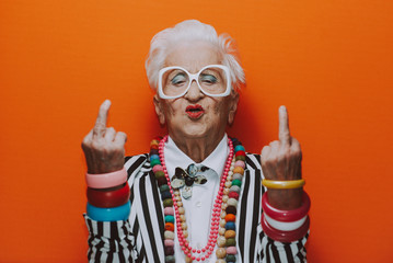 Funny grandmother portraits. Senior old woman dressing elegant for a special ...