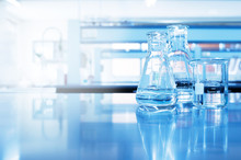 Water In Beaker And Flask Glass In Chemistry Blue Science Laboratory Background