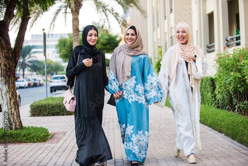 Three women friends going out in Dubai Canvas Print