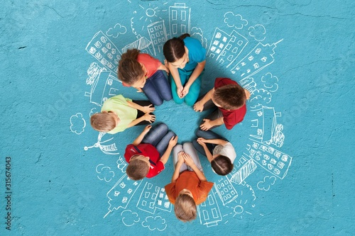Obraz Circle of kids standing group and stacking hands - fototapety do salonu