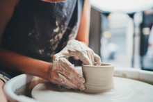 It's All About Form! Closeup Image Of Female Ceramic Artist Working With Pottery Wheel Makes Shape Of Future Mug, Process In Pottery Workshop Creative People Handmade Products