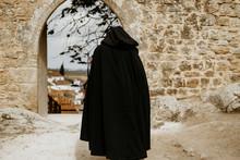 Black Hooded Monk Wearing Long...